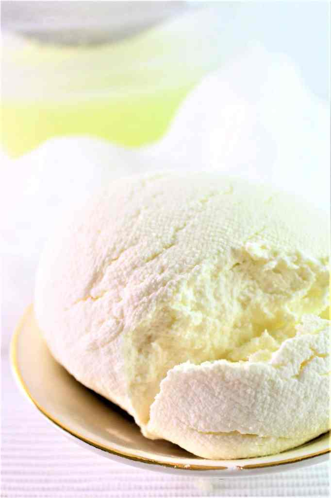firmer ricotta cheese in small gold rimmed bowl