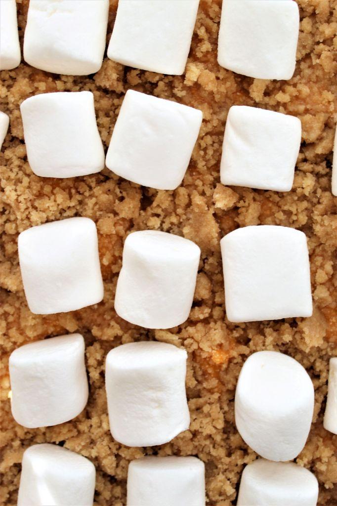 unbaked marshmallows on top of sweet potato souffle
