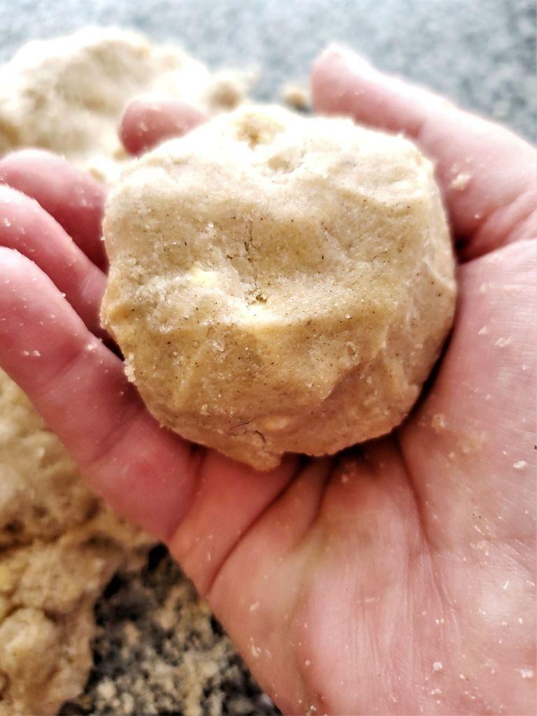large irregular ball of dough in hand