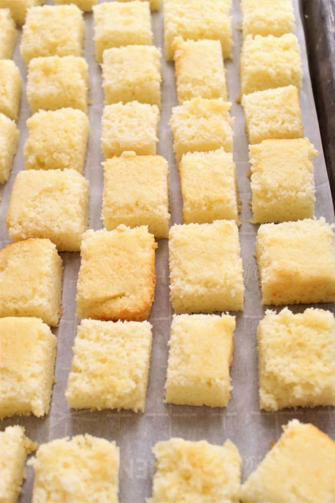 freezing cake squares on parchment-lined baking sheet