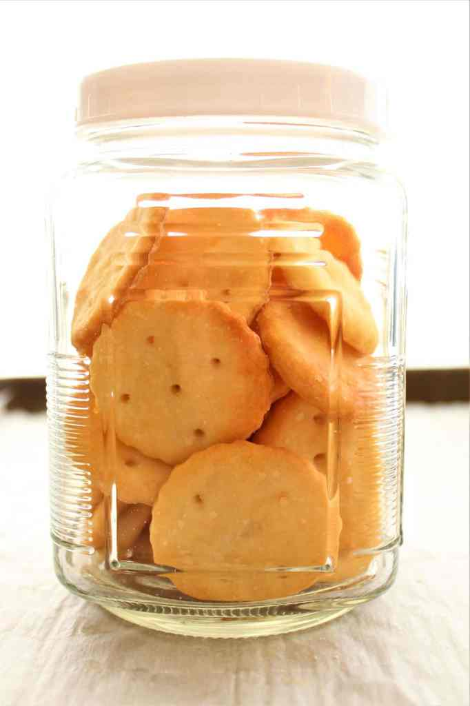 crackers in a glass jar with white lid