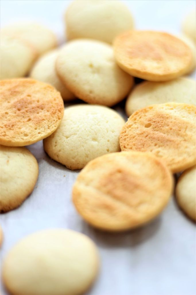 pile of gluten free vanilla wafers on parchment