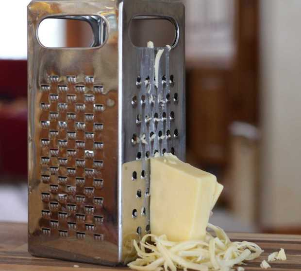 grating cheese for Corn Muffins with Green Chiles and Cheese