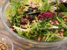 Winter Greens with Pomegranate Seeds and Olives | Letty's Kitchen