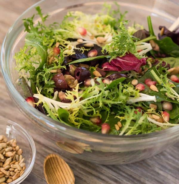 Winter Greens with Pomegranate Seeds and Olives