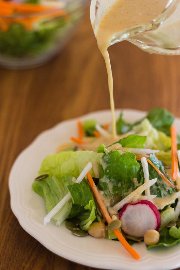 pouring Zesty Easy Hummus Vinaigrette Salad Dressing