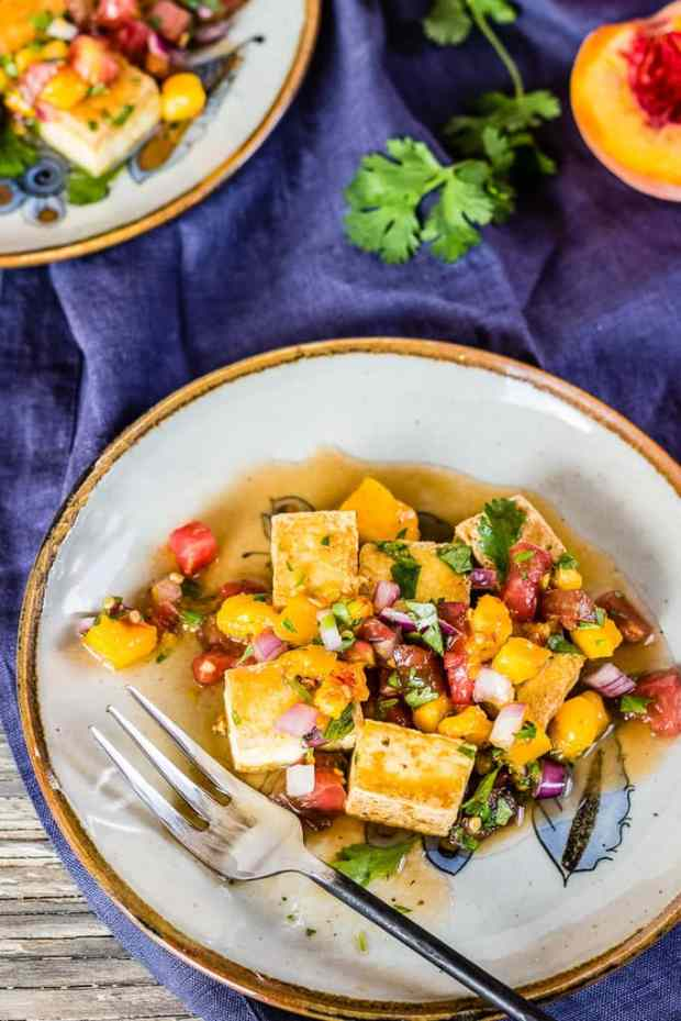 Vegan friendly Peach and Tomato Salsa with Pan Seared Tofu, juicy, sweet, and spicy salsa with with golden, crunchy, tender chewy tofu. Perfect with tortilla chips, quesadillas, and tacos, and as here, with vegan pan seared tofu!