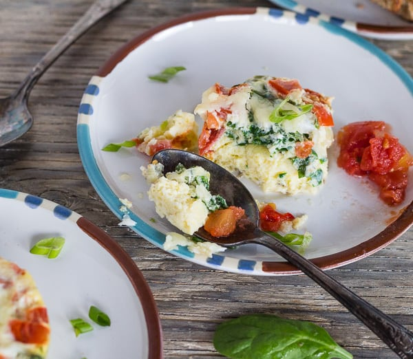 bite from Instant Pot Breakfast Egg Muffins with Parmesan, Spinach, and Tomatoes