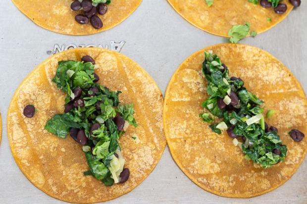 assembling Spinach and Black Bean Enchiladas