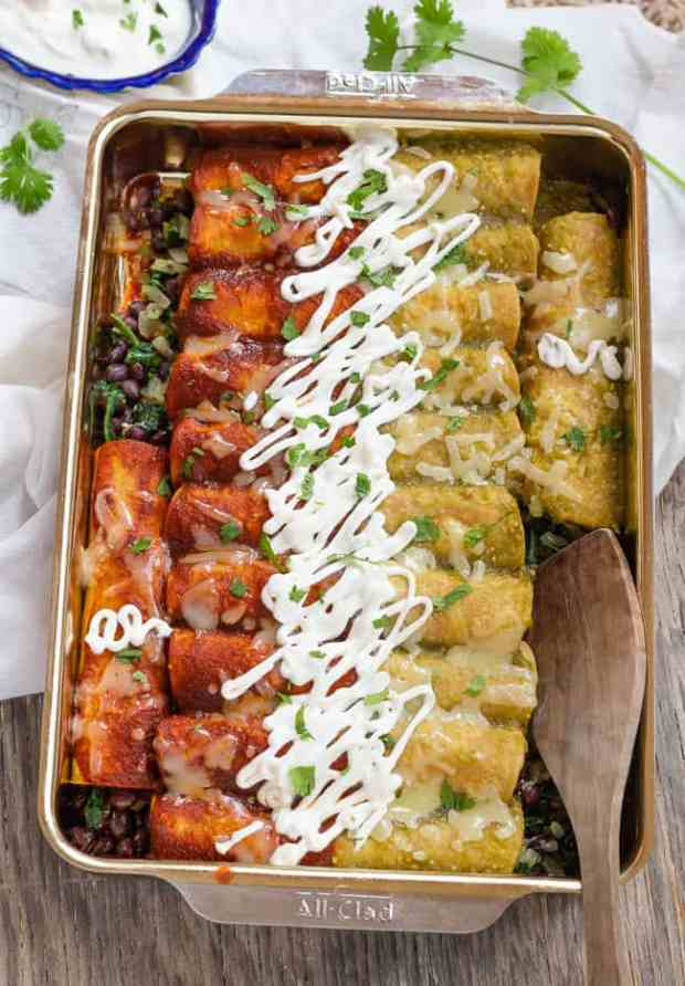 Vertical pan of baked Spinach and Black Bean Enchiladas