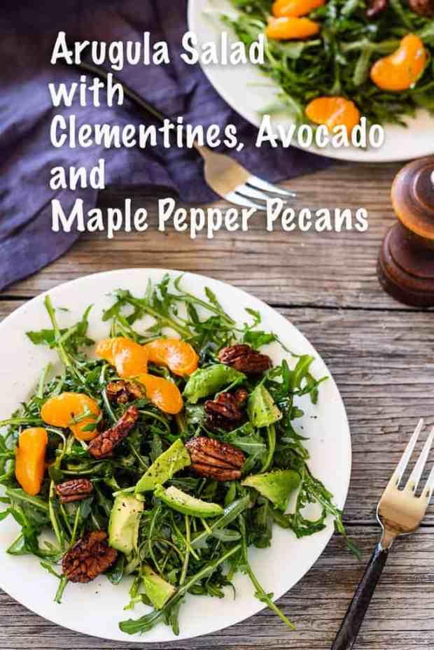 Arugula salad with clementine oranges, maple candied pecans, and bright sherry vinaigrette salad dressing. #arugula #clementines #vegan #pecans #sherryvinegar #avocado #citrus