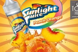 由阳光果汁的桃子桔子