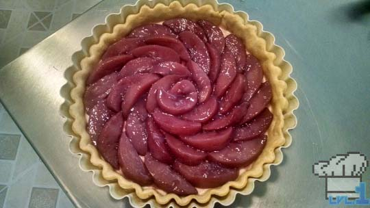The poached peaches are assembled into a fan design for the top of the tart.