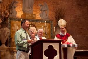Jack Viorel receives the Lewis Award Honoraria from Mrs. Anne Stahel, Msgr. Gerald Lewis, and Bishop Michael Burbidge
