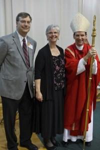 Mrs. Joan Troy, with husband Bob Troy and Bishop Michael F. Burbidge