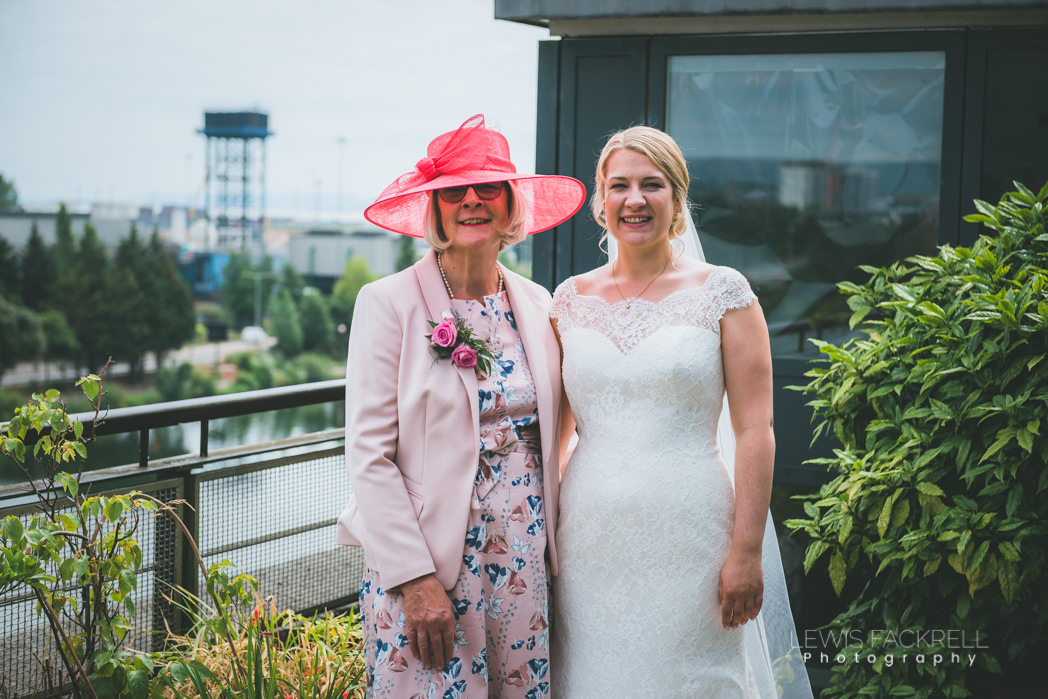 mother of the bride with bride in garden