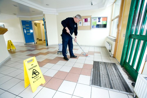 Cartaker mopping the floor at Eddystone Tower.