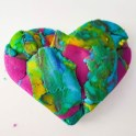 """This purposely out of focus playdough heart was created for Kiyomi by her son Leighlan. """"I made a heart because you are my heart,"""" he said when he gave it to her. Kiyomi will use the photograph for the cover art of her book """"Heart work."""" Photo courtesy: Happy Beautiful Wealthy Photography."""