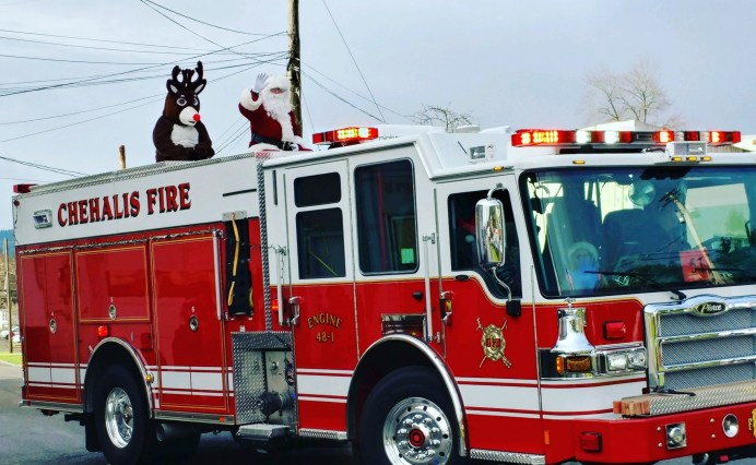 Santa Claus and Rudolf come all the way from the North Pole for the Chehalis Santa Parade. They love to ride in style atop a firetruck. Photo courtesy: Centralia-Chehalis Chamber of Commerce.