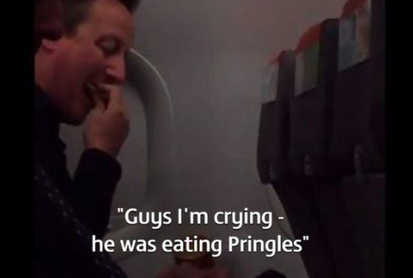 David Cameron tucks into some Pringles.
