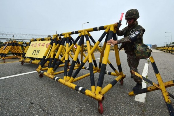 A South Korean soldier installs a barricade at the entrance to a military zone.