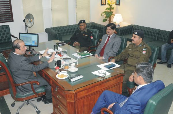 Chairman TEVTA Irfan Qaiser Sheikh talking to DIG Traffic Farooq Mazhar and SSP Traffic Athar Saeed at TEVTA Secretariat