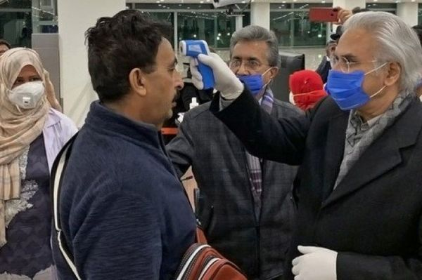State Minister for Health, Zafar Mirza, inspects passengers at the Islamabad International Airport on January 25, 2020, following an outbreak of the coronavirus in China.
