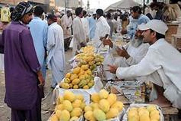 easing small business people in hyd seen purchasing vegetables
