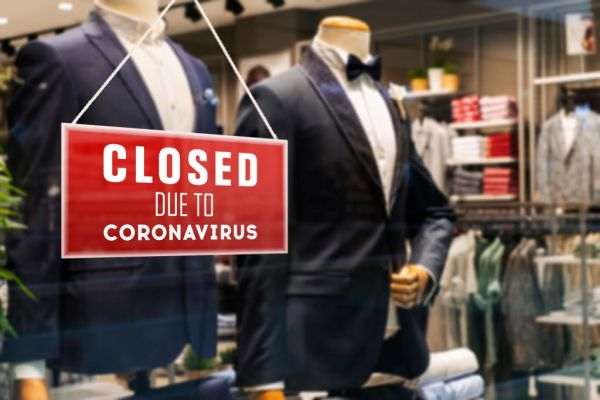Closed Suit Store Due To Coronavirus - stock photo