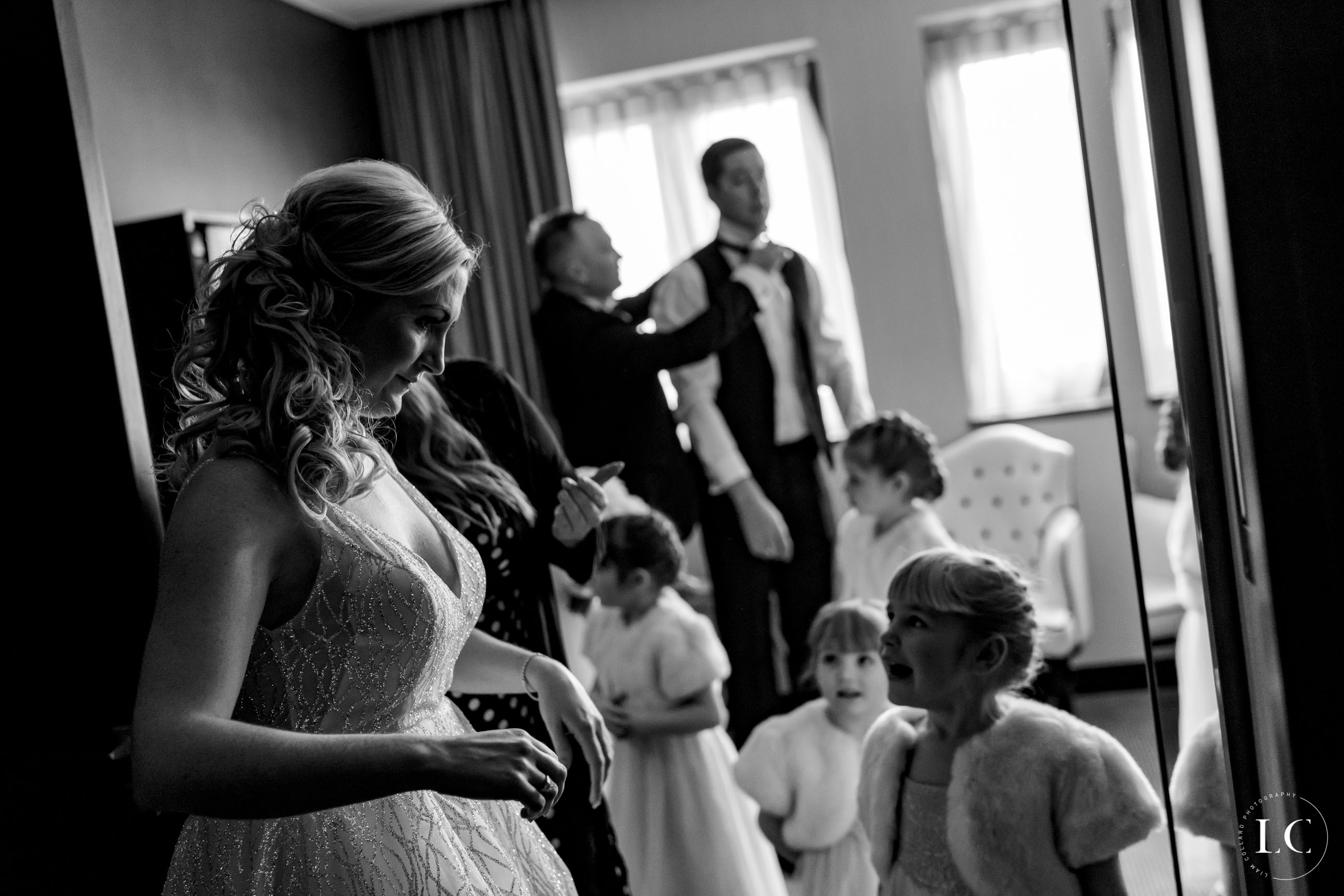 Black and white of bride and children