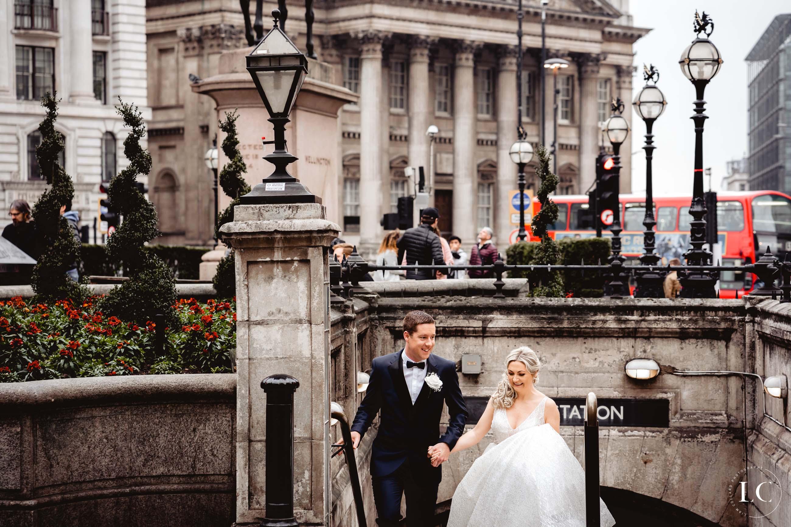 Bride and groom walking in London