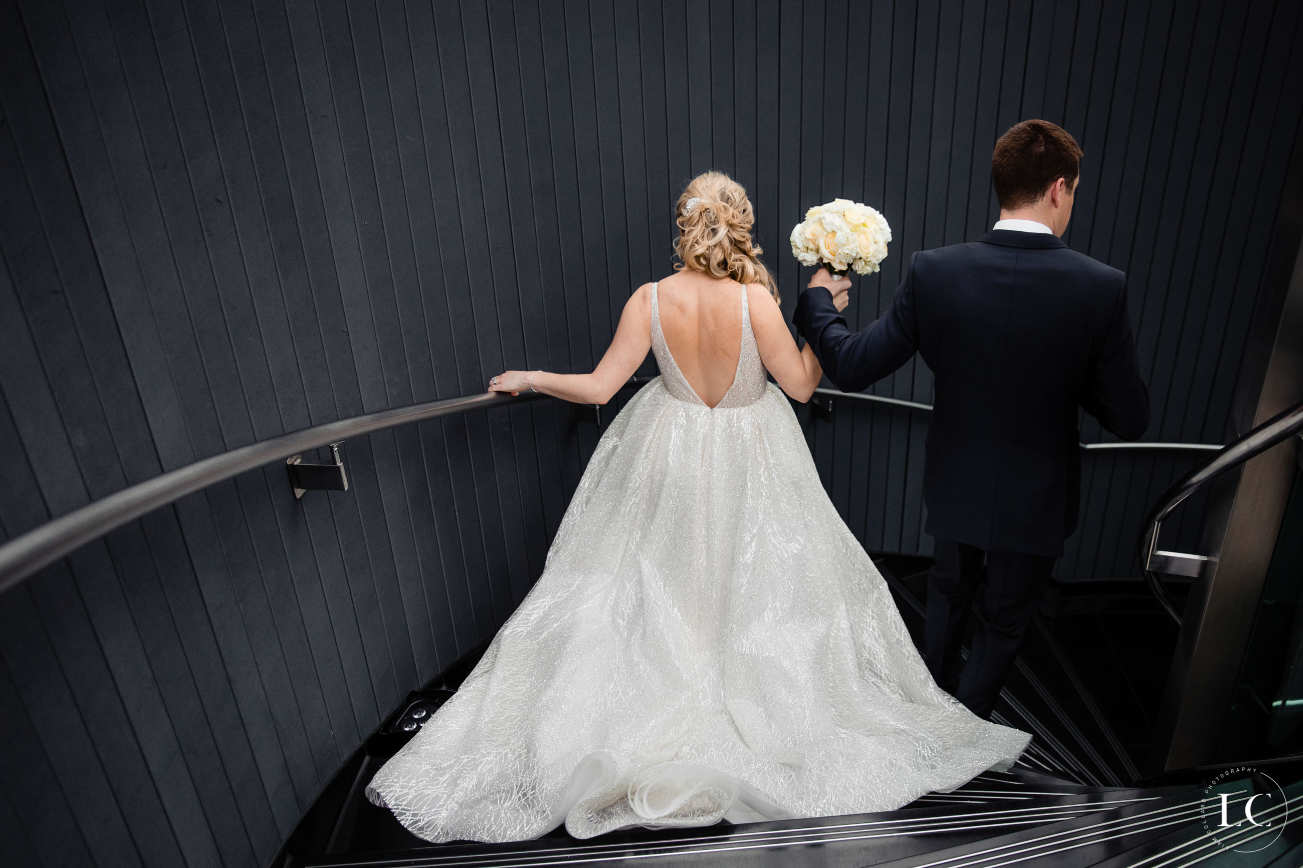Bride and groom from behind