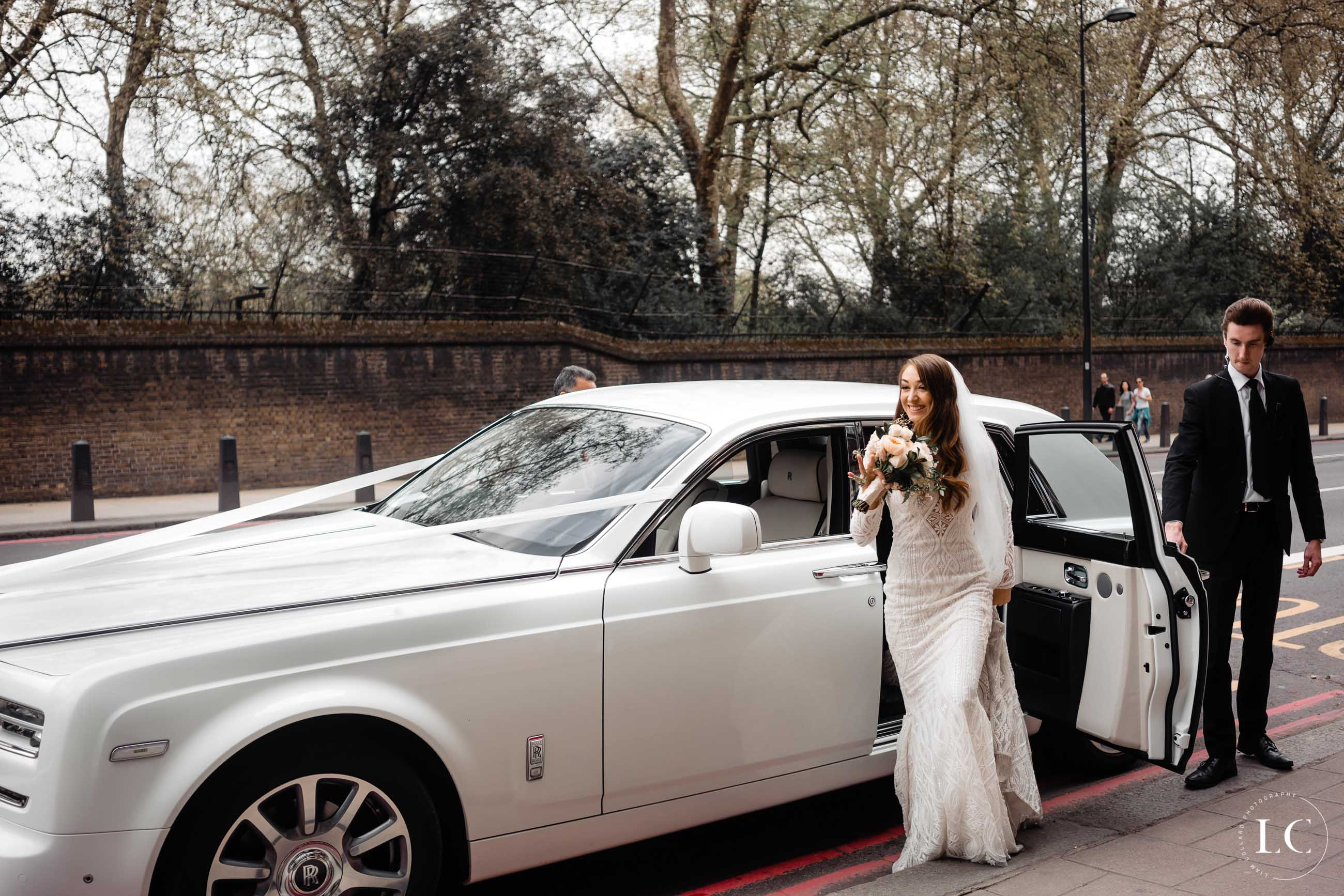Bride next to car