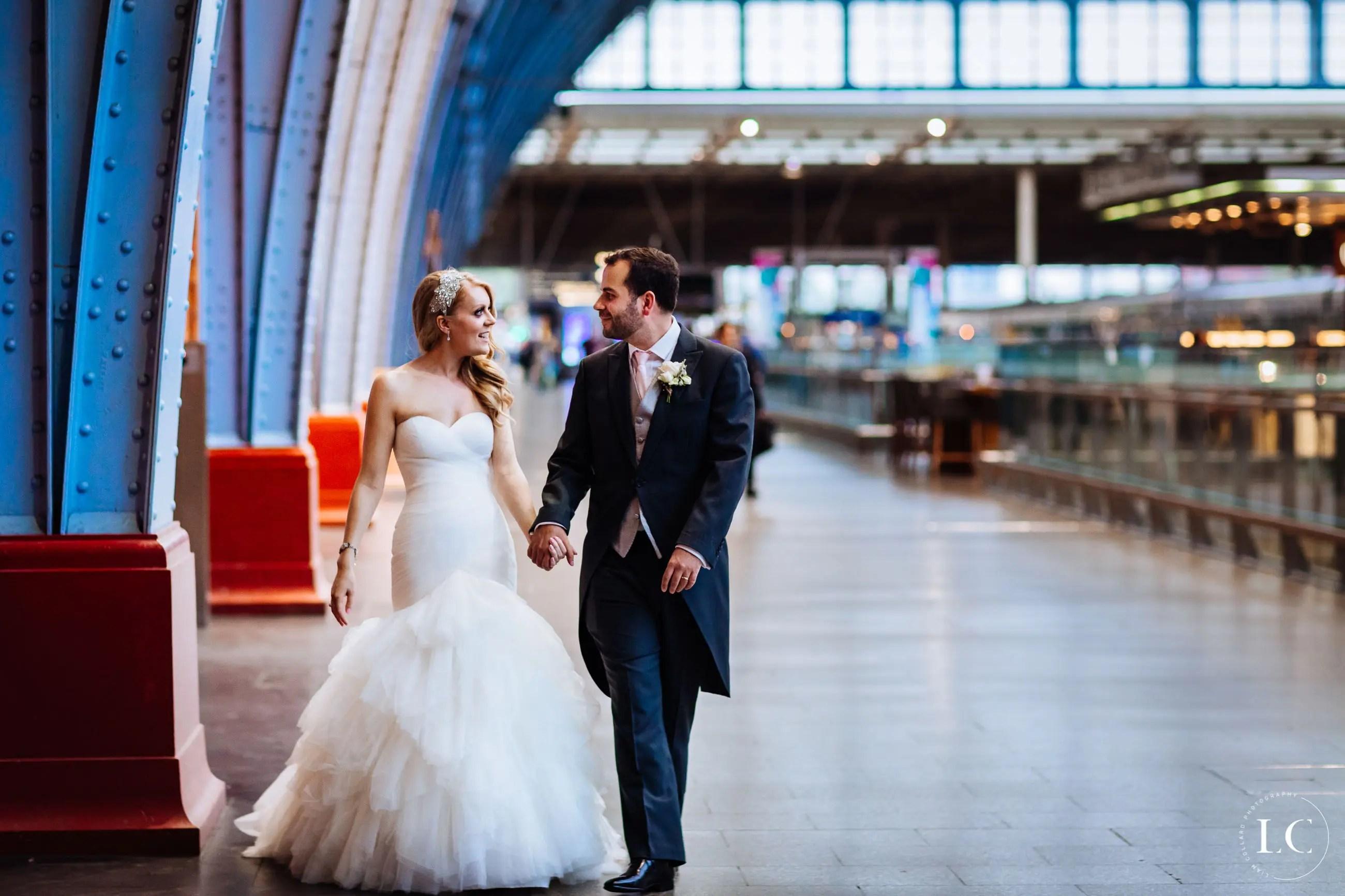 Couple walking in St Pancras Station