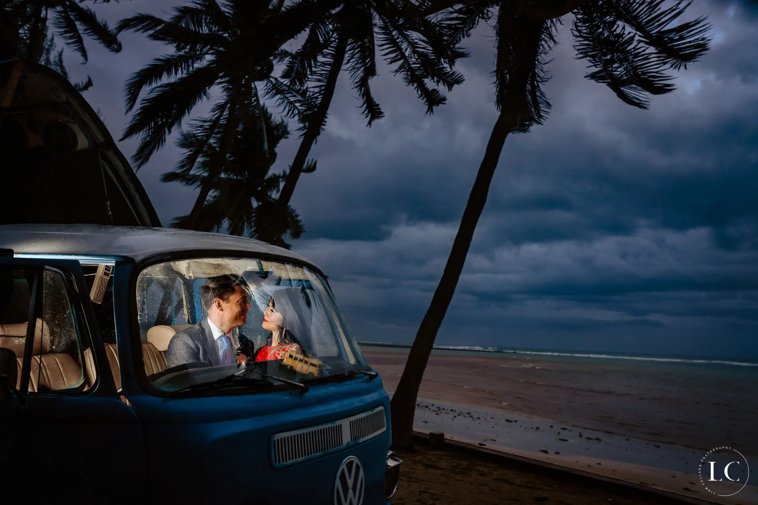 bride and groom in car by the beach