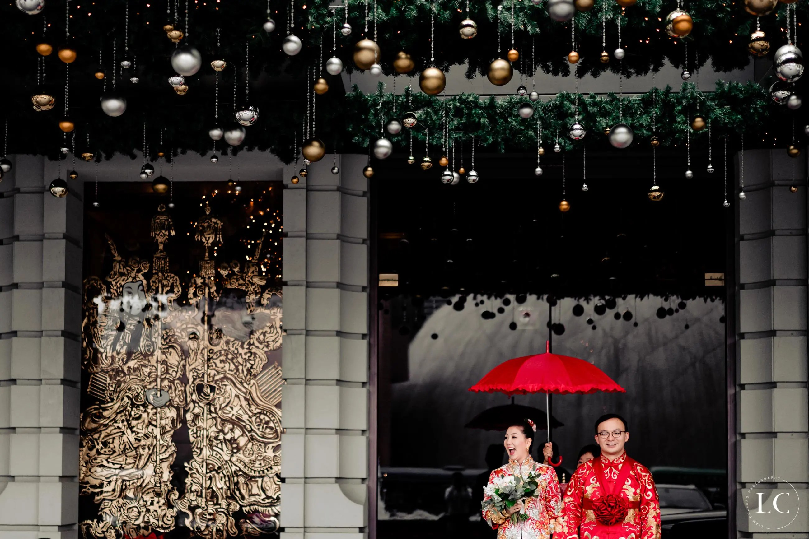 Bride and groom outside with umbrella