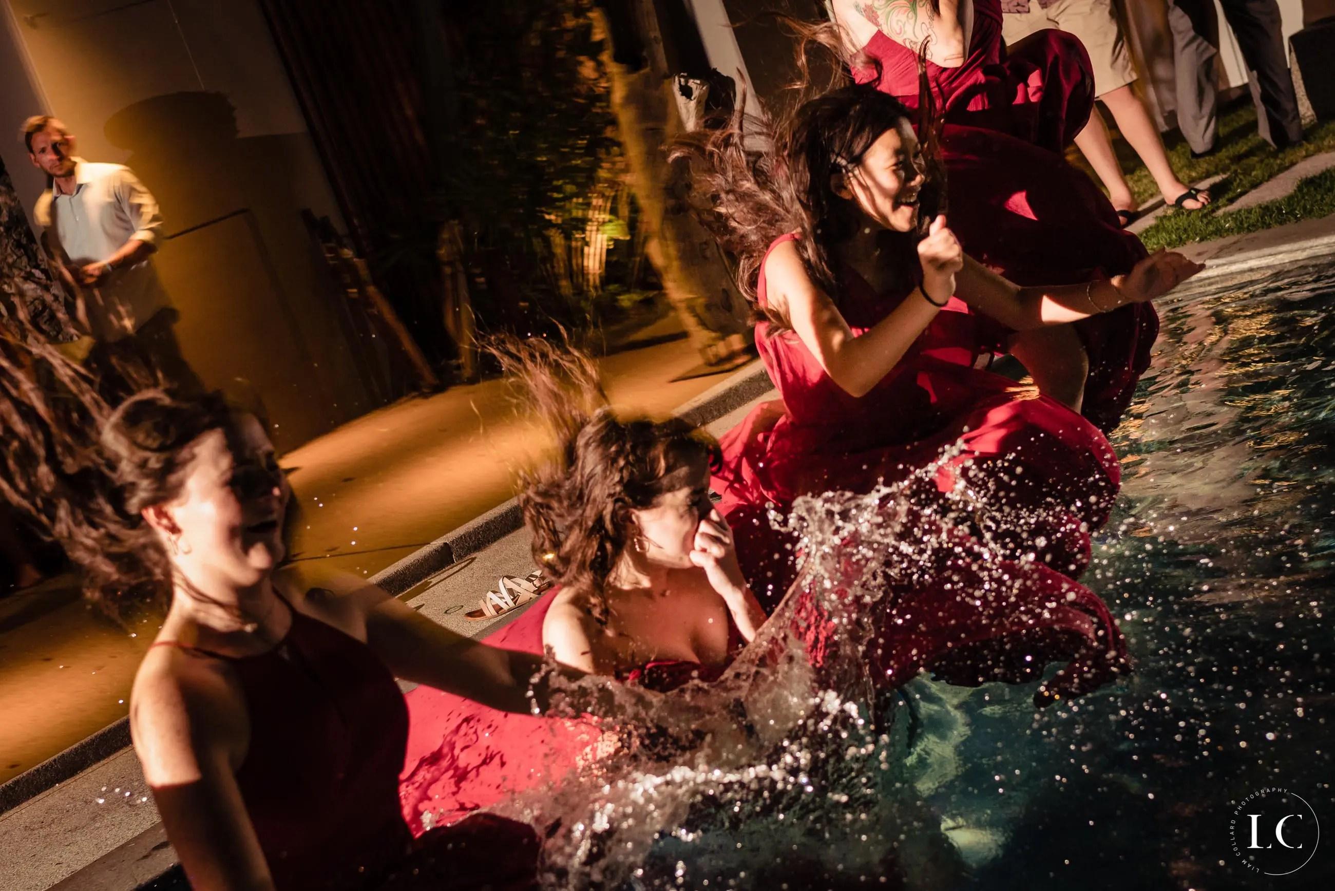 bridesmaids jumping into pool