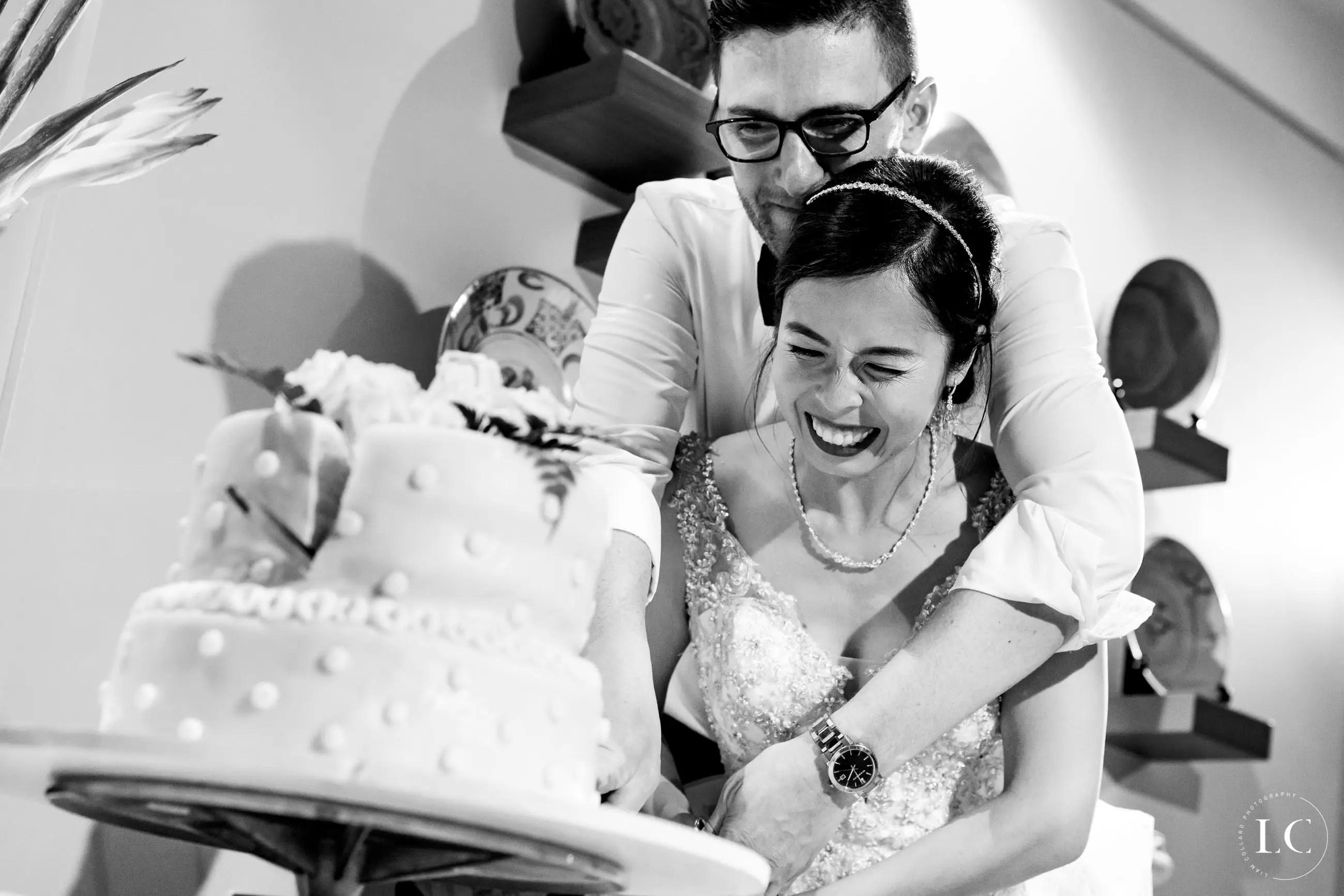 Newly weds cut the wedding cake