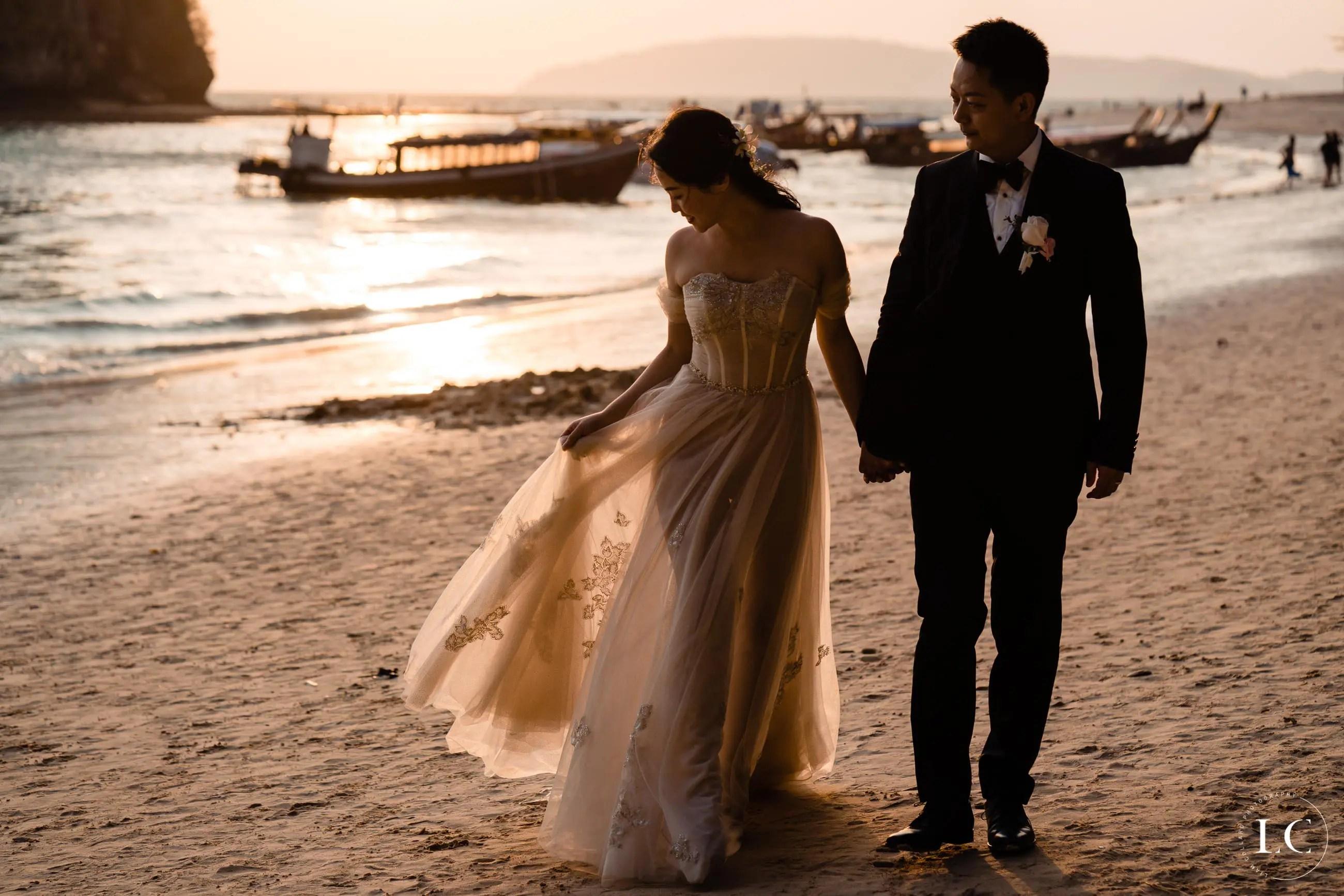 Newly weds walking on beach