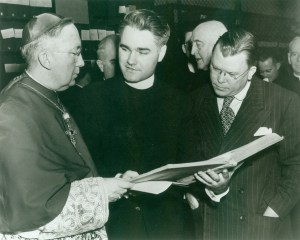 Photograph from the opening ceremony for the Archives at CUA, December 8, 1949, with, left to right, Patrick O'Boyle, Archbishop of DC and Chancellor of the University, Fr. Henry Browne, first CUA Archivist, and Wayne Grover, Archivist of the United States