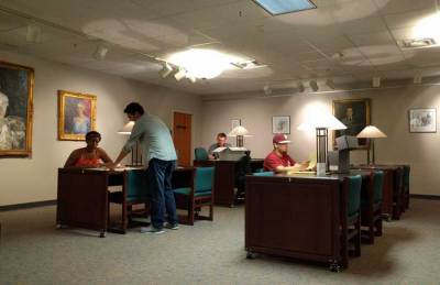 Students discussing and studying in the Claude Pepper Library