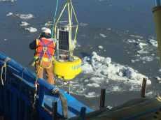 Technicians installing Aridea's buoy in the water