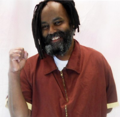 https://i2.wp.com/www.liberationnews.org/wp-content/uploads/2015/03/Mumia_raised_fist_020612_web.jpg?resize=400%2C389&ssl=1