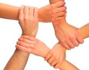Five hands joined together