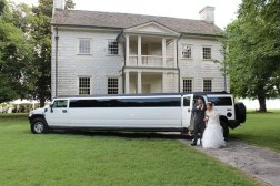 white limo with a wedding couple