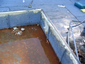 Standing water within roof curb space