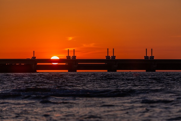 Beautiful shot of a storm surge barrier in Zeeland province of the Netherlands during the sunset