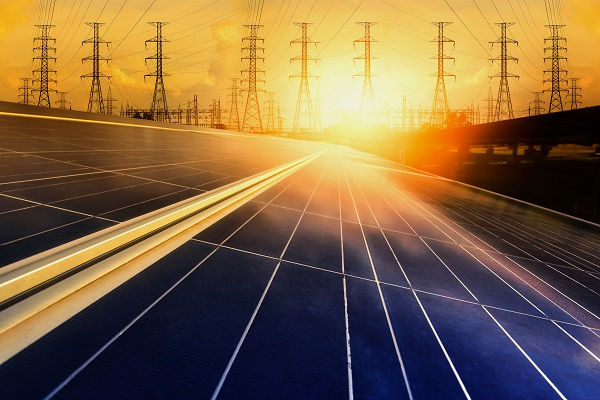 Alternative energy for energy conservation of the world (Solar panels with power plants in the background)