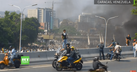 Violence Erupts in Caracas; Guaido Calls for Military Uprising