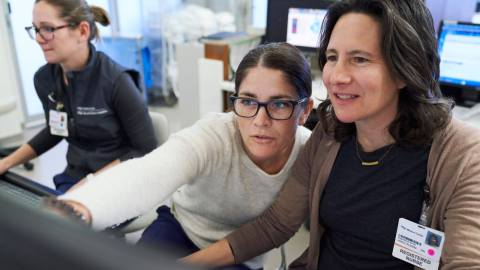 Two UCSF clinicians working together at a desktop computer